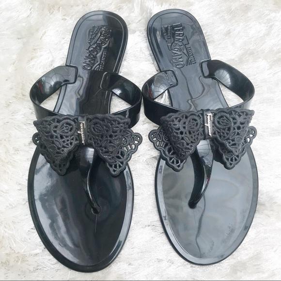72417b276d0 FERRAGAMO Pandy Lace Bow Flip Flops. M 5b0ce6033afbbda357cb9c69